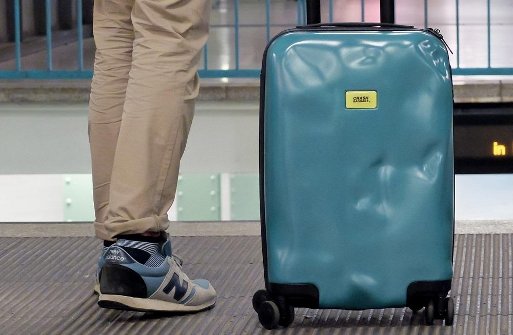 Повреждение чемодана